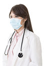 Asian doctor with protective mask isolated on white background Royalty Free Stock Photos