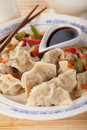 Asian dumplings with vegetable and soy sauce dim sum cooked Royalty Free Stock Photo