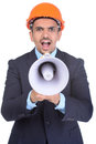 Asian engineer constructions happy young architect screaming in megaphone against a white background and clipping path Royalty Free Stock Photo