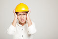Asian engineer girl with hard hat got headache on gray background Stock Photos