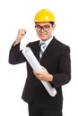 Asian engineer man success look at camera with blueprints Royalty Free Stock Photo