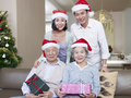 Asian family with christmas hats portrait of an and gifts Stock Images