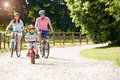 Asian Family On Cycle Ride In Countryside Royalty Free Stock Photo