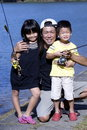 Asian family fishing portrait Stock Images