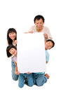 Asian family holding a white board Royalty Free Stock Images