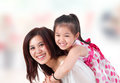 Asian family home mother child piggyback ride indoor room Stock Image