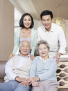 Asian family home portrait of a happy Stock Photos