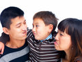 Asian family making funny faces on white Stock Photo