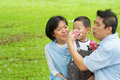 Asian family playing bubble wand Royalty Free Stock Photos