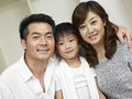 Asian family portrait of an of three Stock Image