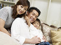 Asian family portrait of an of three Royalty Free Stock Image