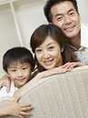 Asian family portrait of an of three Stock Photo