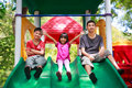 Asian family sitting on playground Stock Photo
