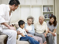 Asian family three generation talking in living room Stock Photo