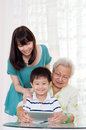 Asian family three generations having fun on the internet Stock Photo