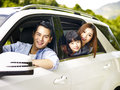 Asian family traveling by car Royalty Free Stock Photo