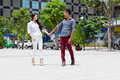 Asian fashion couple holding hands looking face Royalty Free Stock Photo