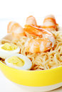 Asian fast food noodle close up chines in plate with shrimps and eggs Royalty Free Stock Photos