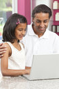 Asian Father & Daughter using a Laptop at Home Stock Photography