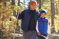 Asian father and son hiking in a forest, embracing Royalty Free Stock Photo