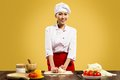 Asian female chef cooking pizza dough Royalty Free Stock Photos