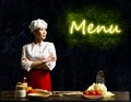 Asian female chef looking at the glowing menu Royalty Free Stock Photo