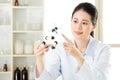 Asian female chemist teacher point at molecular model explain Sc Royalty Free Stock Photo