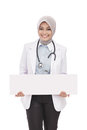 Asian female doctor with stethoscope holding blank white board Royalty Free Stock Photo