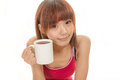 Asian female holding coffee cup chinese in red dress with Royalty Free Stock Photos