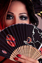 Asian female holding an Japanese folding fan Royalty Free Stock Photography