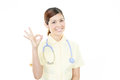 Asian female nurse with ok hand sign Royalty Free Stock Photo