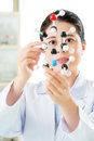 Asian female scientist research for human longevity secret holding and looking at molecular model doing the science antidote Stock Photography