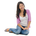 Asian female sitting on floor portrait of smiling and isolated over white background Royalty Free Stock Photo