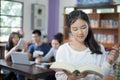 Asian Female Students Holding ...