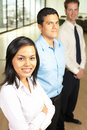 Asian Female Team Leader Row of Coworkers Royalty Free Stock Photos