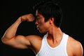 Asian fit man posing his muscles on black background Stock Photos