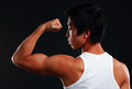 Asian fit man posing his muscles on black background Stock Images