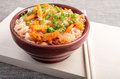 Asian food of rice noodles in a small brown wooden bowl Royalty Free Stock Photo