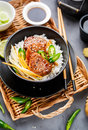 Asian food - roast meat with rice and vegetables. Royalty Free Stock Photo