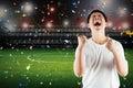 Asian football fan celebrate Royalty Free Stock Photo