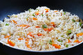 Asian fried rice cooking mix veg in pan Stock Photos
