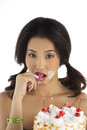Asian girl with birthday cake eating Royalty Free Stock Images