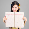 Asian girl in cheongsam qipao with chinese book is Stock Photo