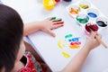 Asian girl doing fingerprints using drawing tools, art education Royalty Free Stock Photo