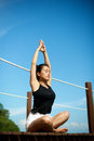 Asian girl doing Yoga at the pier Royalty Free Stock Photo