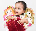 Asian girl with dolls Stock Photos