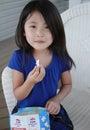 Asian girl eating popcorn Royalty Free Stock Photo