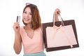 Asian girl enjoy shopping wiht credit card and shopping bag isol Royalty Free Stock Photo