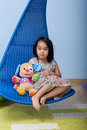Asian girl with favourite bear at home Stock Images