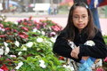 Asian girl at a flower garden Stock Photo